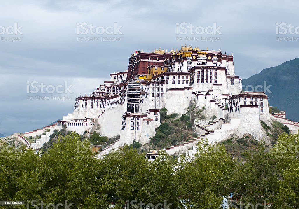Panorama of the white Potala Palace over the mountain stock photo