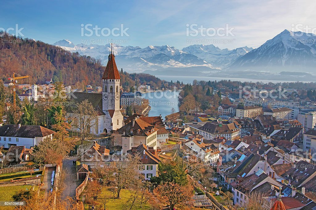 Panorama of Thun Church and Town with Thunersee and Alps stock photo