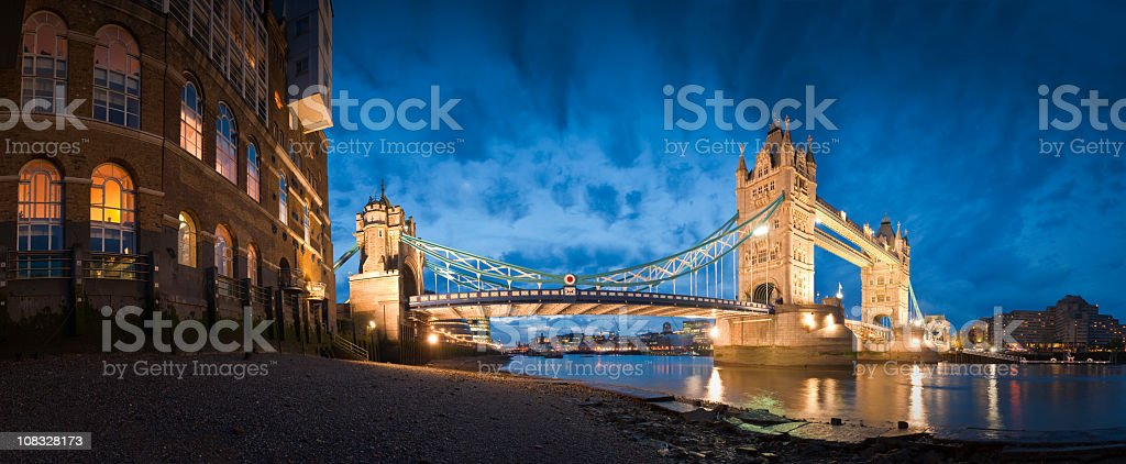 Panorama of Tower Bridge in London at night with lights royalty-free stock photo