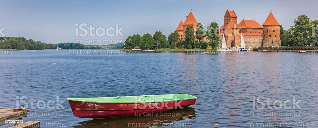 Panorama of Trakai castle and a boat in lake Galve stock photo