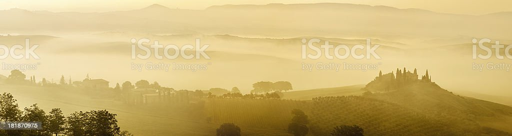 Panorama of Tuscan Landscape With Morning Fog stock photo