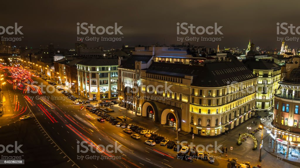 panorama of urban roofs and night traffic stock photo
