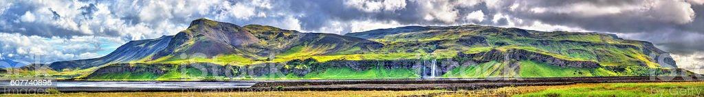 Panorama of volcanic massif Eyjafjoll with Seljalandsfoss and Gljufrafoss waterfalls stock photo