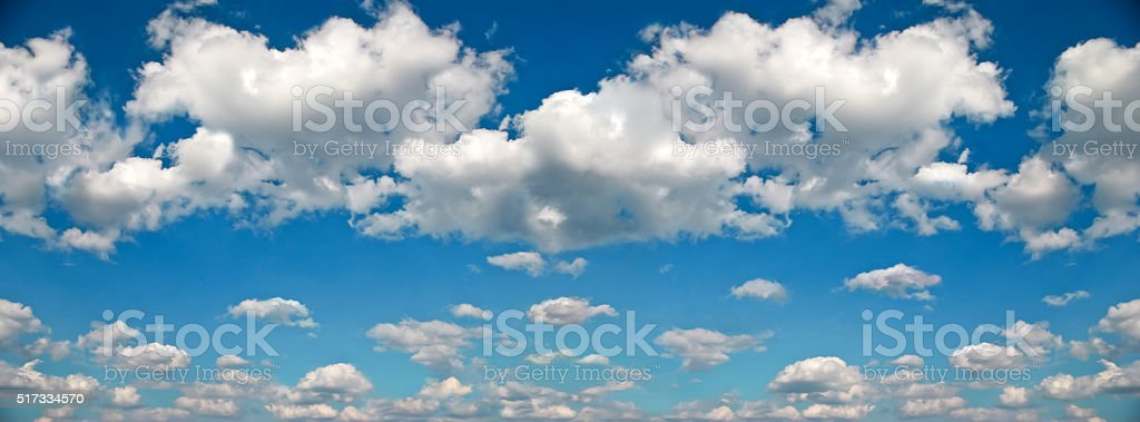 Panorama of white clouds against a blue sky stock photo