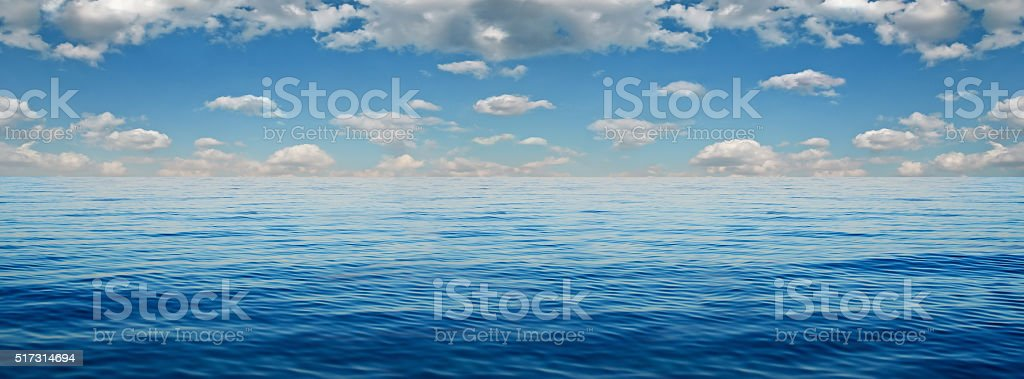 Panorama of white clouds on a background of blue sea stock photo
