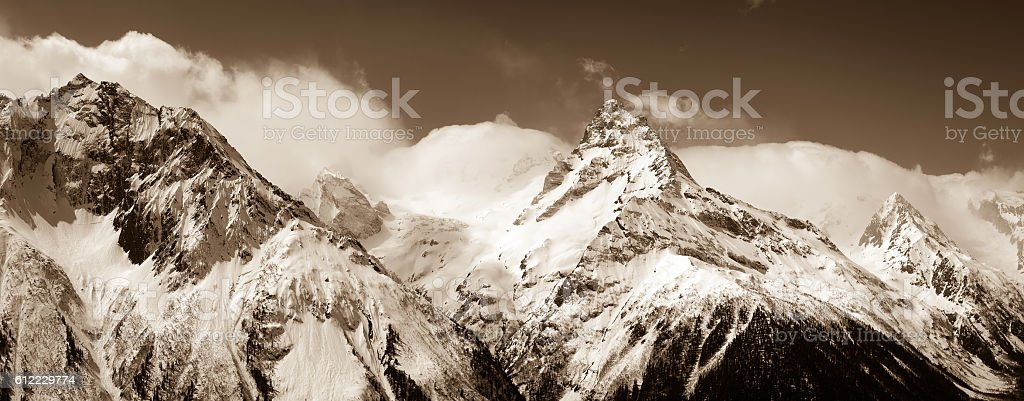 Panorama of winter mountains in clouds stock photo