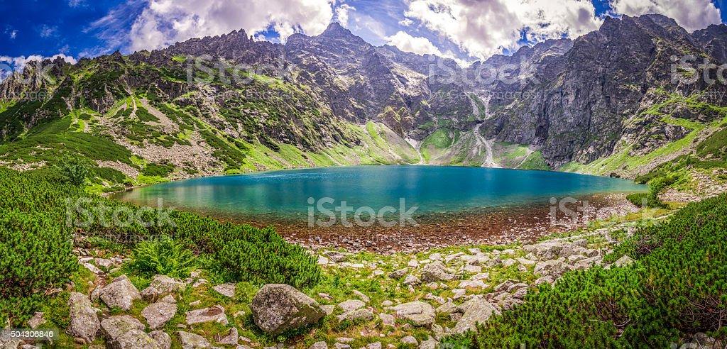 Panorama of wonderful lake in the Tatra Mountains at sunrise stock photo