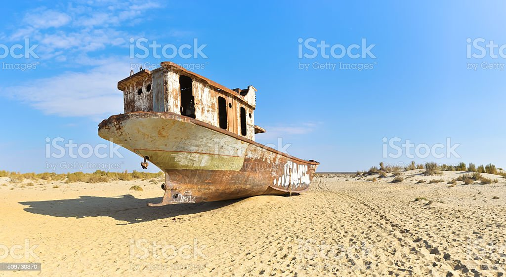 Panorama. Old ship in the Aral desert, rear view stock photo