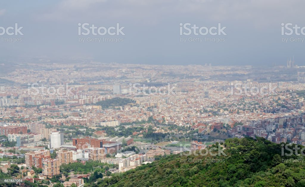 Panorama on Barcelona city at hot summer day from Montjuic castle stock photo