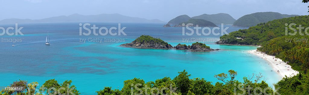 Panorama picture of Trunk Bay with clear blue water royalty-free stock photo