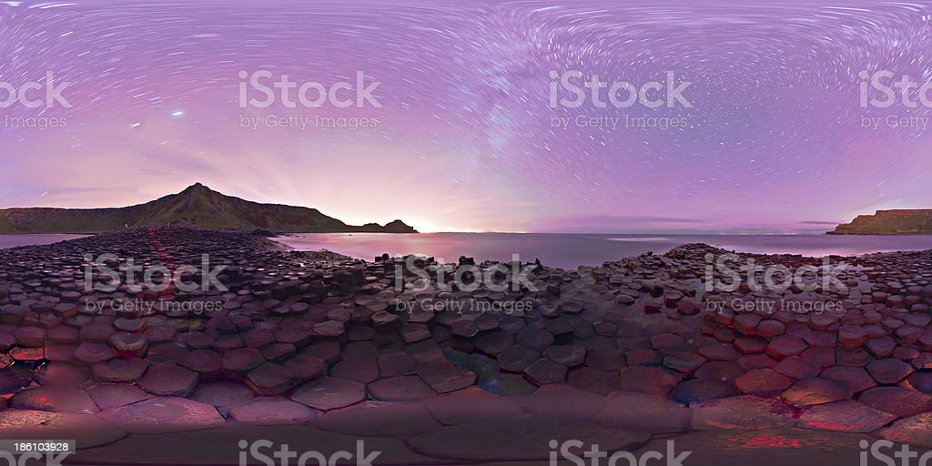 Panorama purple starry night sky Giants Causeway County Anterim royalty-free stock photo