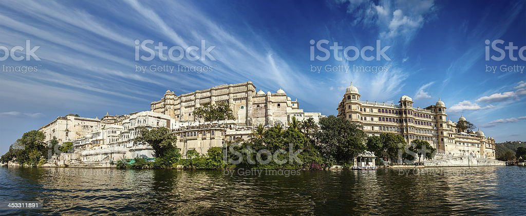 Panorama river view of city palace in udaipur, India stock photo