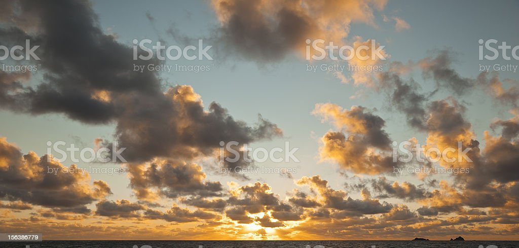 Panorama sunset over the cornish coast with dramatic clouds. royalty-free stock photo
