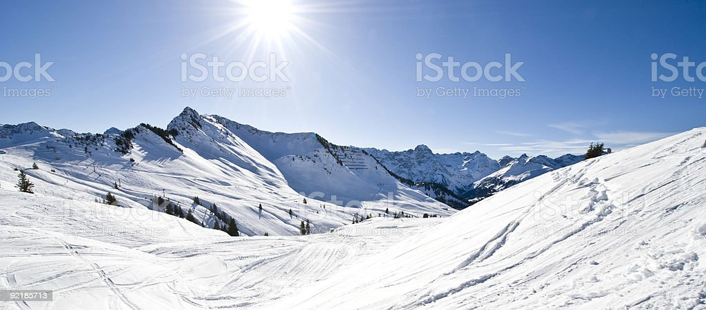 Panorama view of a snowy mountain in the sunlight royalty-free stock photo