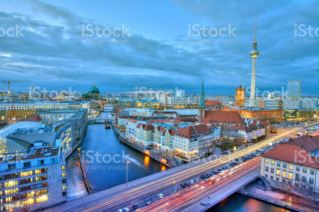 Panorama view of Berlin skyline at sunset, with TV tower stock photo