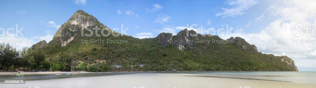 panorama view of long-big mountain and fishing boat stock photo