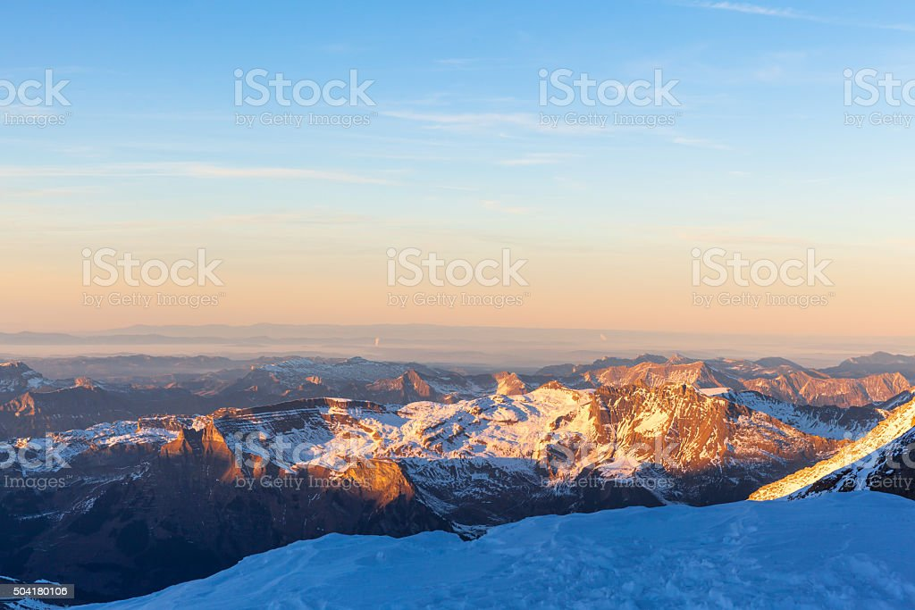 Panorama view of the Bernese Alps from Jungfraujoch at dusk stock photo