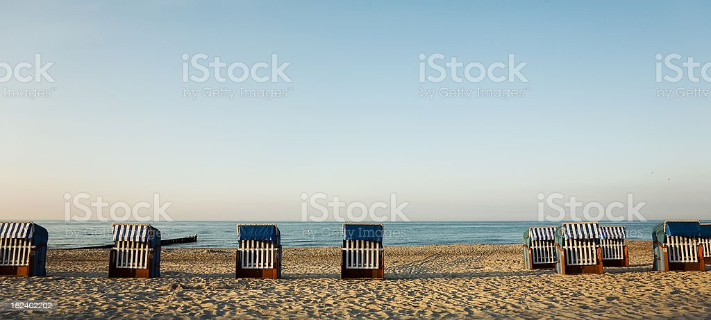 Panorama with Hooded beach chairs stock photo