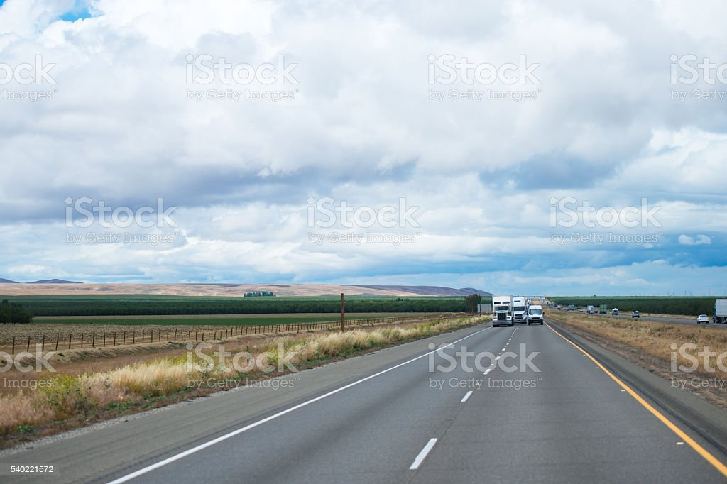 Panorama with road traffic of semi trucks and van stock photo