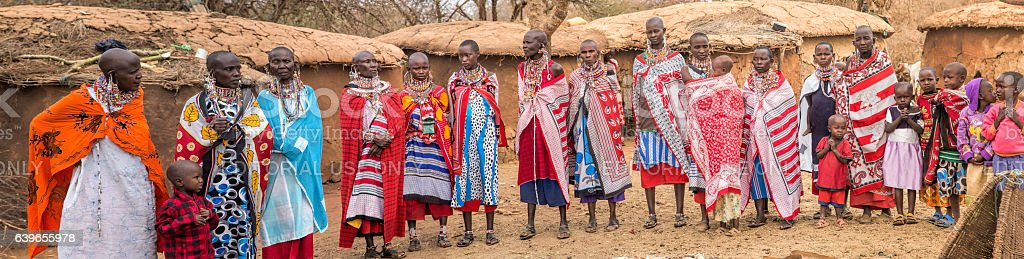 Panorama with women and children i Maasai village, Kenya. stock photo