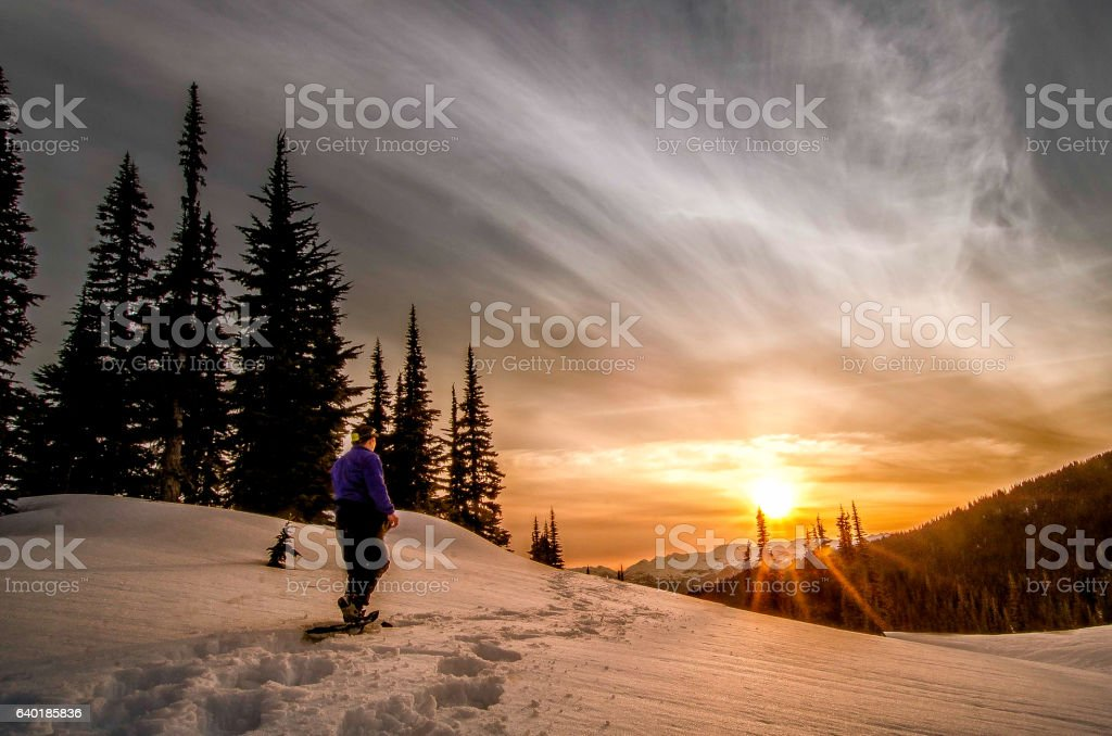 Panoramic alpine mountain landscape in winter during sunset stock photo