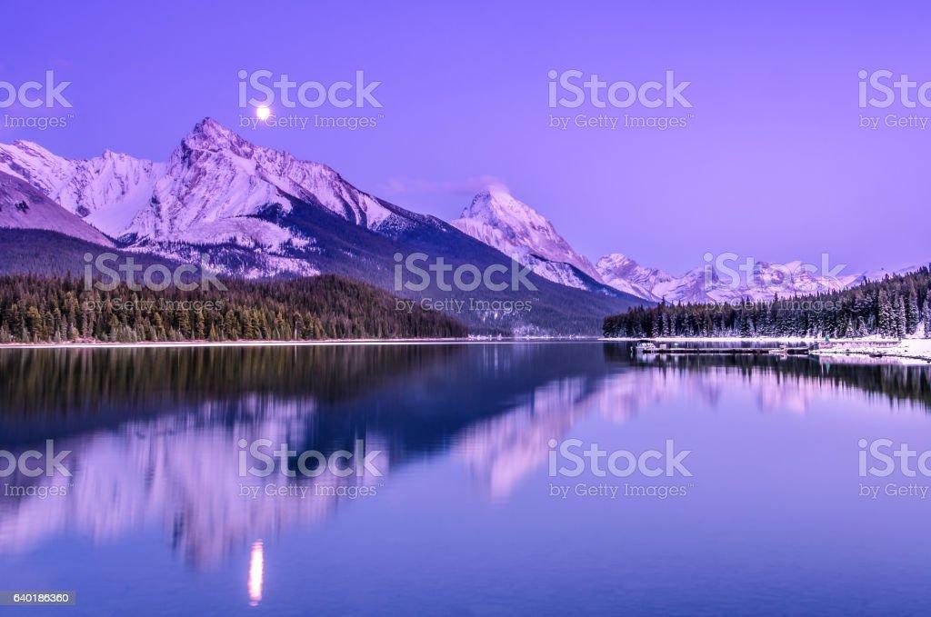 Panoramic autumn sunset mountain landscape at Maligne lake, Jasper. stock photo