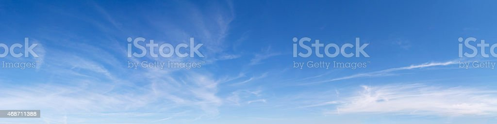 Panoramic blue sky with light clouds stock photo