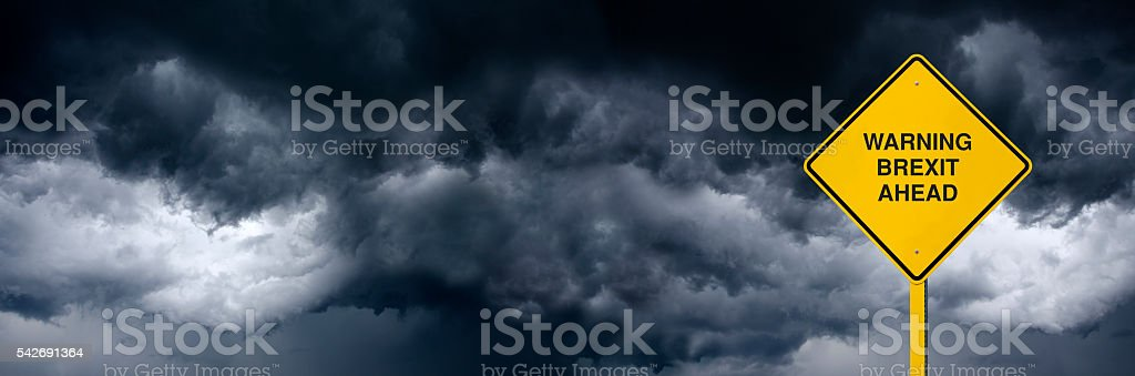 Panoramic BREXIT Road Sign in Front of Storm Clouds stock photo