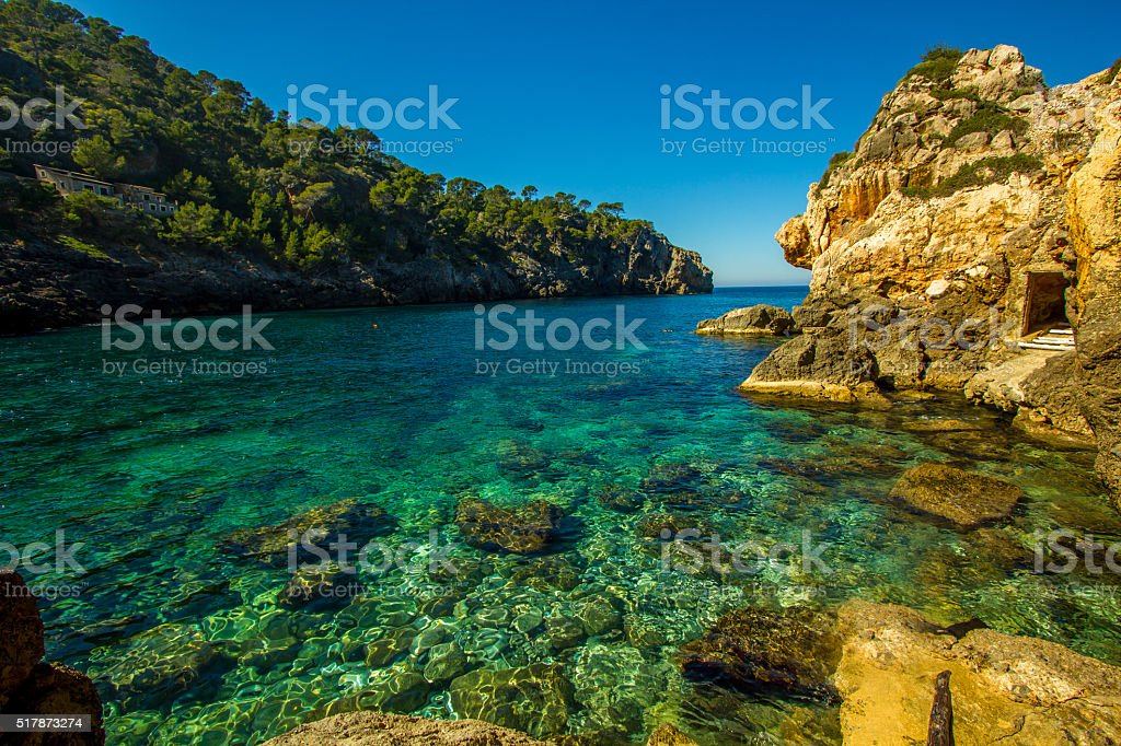 Panoramic Cala Deia tropic empty beach turquoise mediterranean Palma Mallorca stock photo