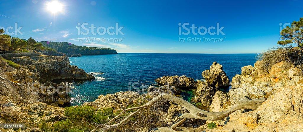 Panoramic Cala Deia tropic empty beach turquoise mediterranean Palma Mallorca stock photo