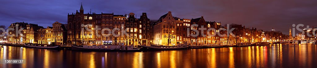 Panoramic city scenic at night in Amsterdam the Netherlands stock photo