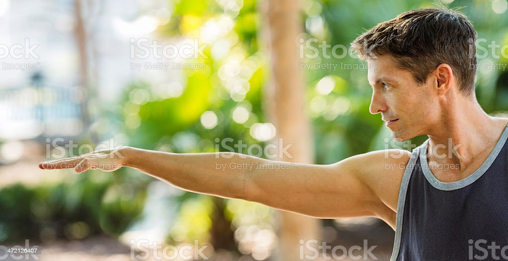 Panoramic close-up of man in warrior pose royalty-free stock photo