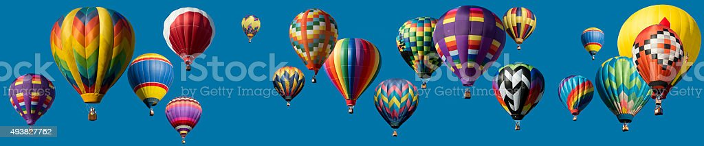 Panoramic composite Hot Air Balloons Flying over blue clear sky stock photo