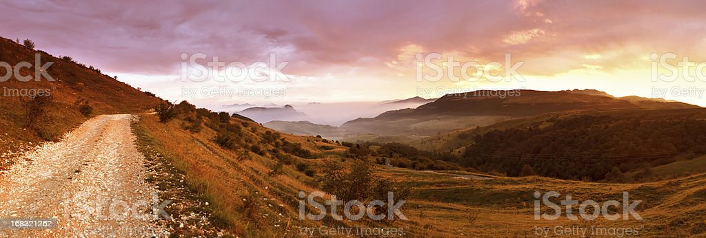 Panoramic Country Road at Sunrise above the Mountains royalty-free stock photo