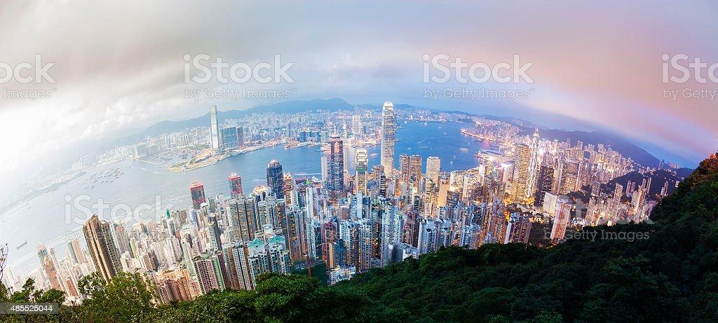 Panoramic day to night transition of Hong Kong stock photo