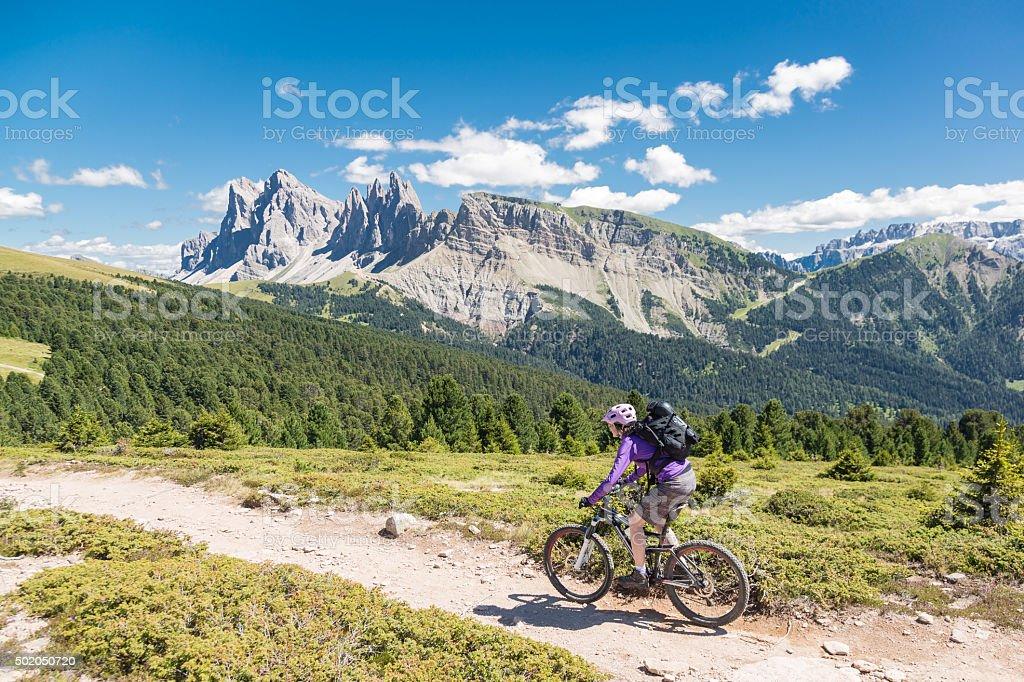 Panoramic Downhill Biking in the Dolomites, Italy stock photo