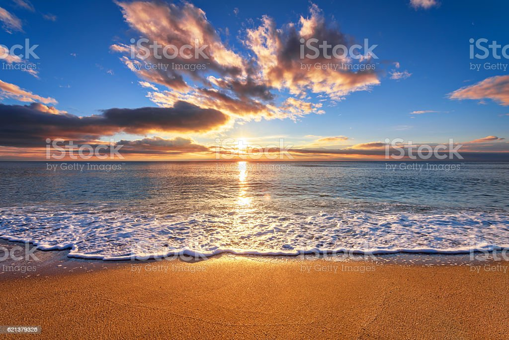 Panoramic dramatic sunset sky and tropical sea at dusk stock photo