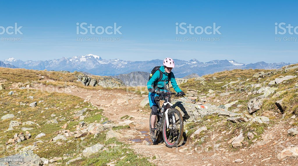 Panoramic high altitude single trail biking, Switzerland stock photo