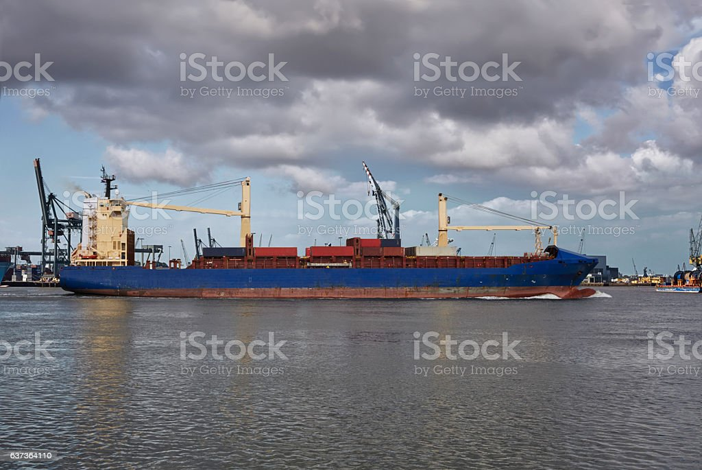 Panoramic image of a container ship passing cranes in Rotterdam stock photo