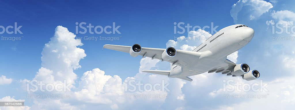 Panoramic image of commercial jet airplane in flight stock photo