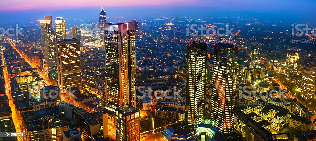 Panoramic Image of Frankfurt Skyline Illuminated at Night, Aerial View stock photo