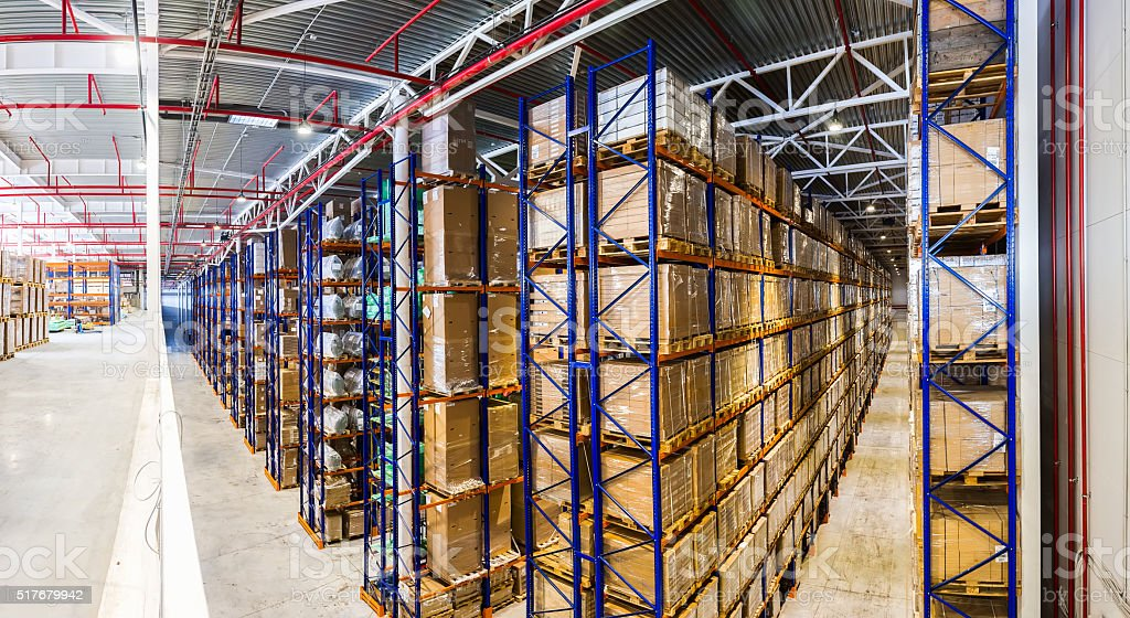 Panoramic Interior Large modern storehouse with some goods stock photo