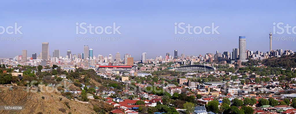 Panoramic Johannesburg landscape with soccer and sport stadiums in foreground royalty-free stock photo