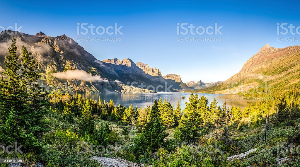 Panoramic landscape view of Glacier NP mountain range and lake stock photo