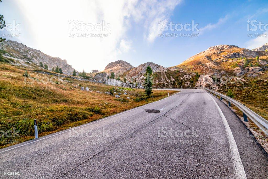 Panoramic mountain pass road in dolomites stock photo
