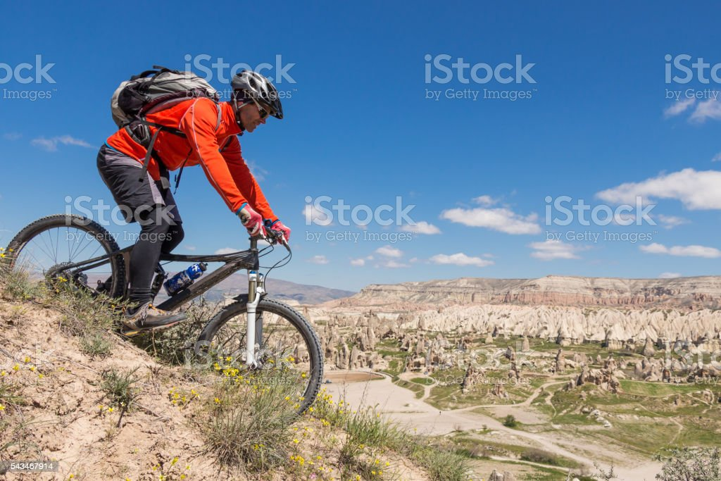 Panoramic mountainbike downhill in scenic Cappadocian landscape, Turkey stock photo