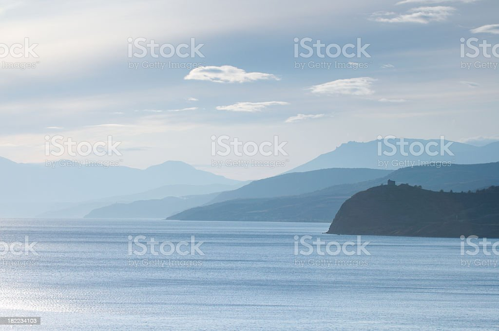 Panoramic ocean with mountains in distance stock photo