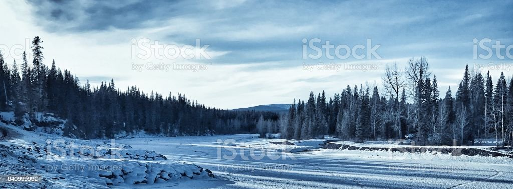Panoramic of a frozen Elbow River in Bragg Creek,Alberta,Canada stock photo