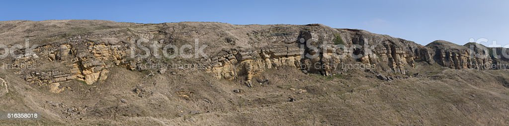 Panoramic of a line of sedimentary rock stock photo