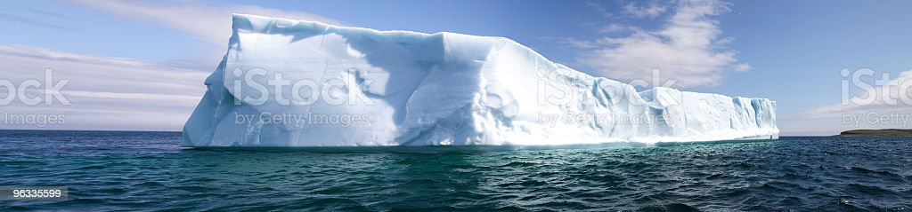 A panoramic of an iceberg in the ocean stock photo
